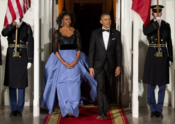 President Barack Obama and first lady Michelle Obama arrive at the North Portico of the White House in Washington to greet French President François Hollande, who is arriving for a State Dinner.  (AP Photo/ Evan Vucci, File)