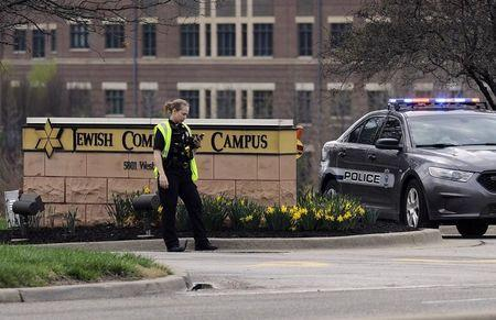 An Overland Park Kansas police officer guards the entrance to the scene of a shooting at the Jewish Community Center of Greater Kansas City.  (REUTERS/Dave Kaup)
