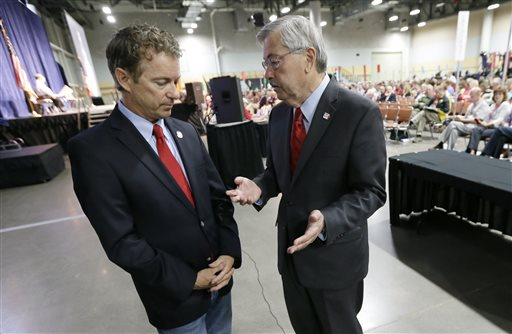 Iowa Gov. Terry Branstad, right, talks with Sen. Rand Paul, R-Ky., left (AP Photo/Charlie Neibergall)