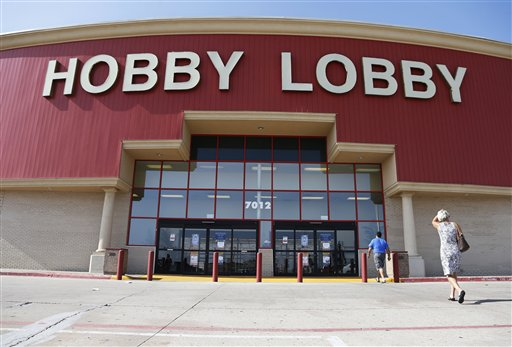 Customers walking into a Hobby Lobby store in Oklahoma City.  (AP Photo/Sue Ogrocki, File)