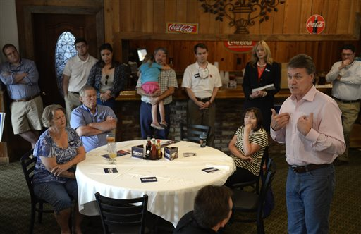 U.S. Senate candidate David Perdue talks to supporters  (AP Photo/Savannah Morning News, Brittney Lohmiller)