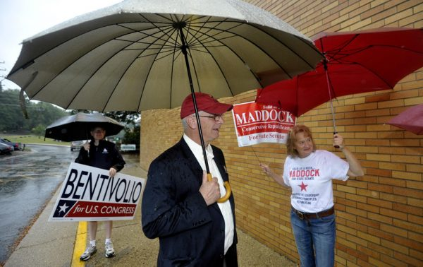 U.S. Congressman Kerry Bentivolio, center, talks with campaign volunteers (AP Photo/Detroit News, Todd McInturf )