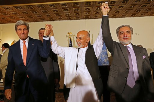 Secretary of State John Kerry, Afghanistan's presidential candidate  Ashraf Ghani Ahmadzai, and Afghan presidential candidate Abdullah Abdullah  (AP Photo/Rahmat Gul)