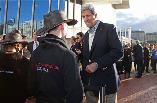 U.S. Secretary of State John Kerry right, chats with school children while visiting the National Maritime Museum in Sydney  (AP Photo/Rick Rycroft)