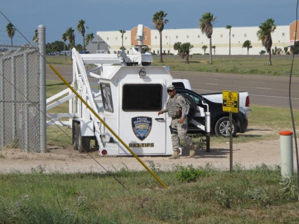 A Texas National Guardsman exits an observation tower in Hidalgo, Texas, on Thursday.  (AP Photo/Christopher Sherman)