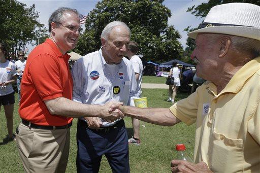 Democratic U.S. Sen. Mark Pryor, left, campaigns for re-election (AP Photo/Danny Johnston)