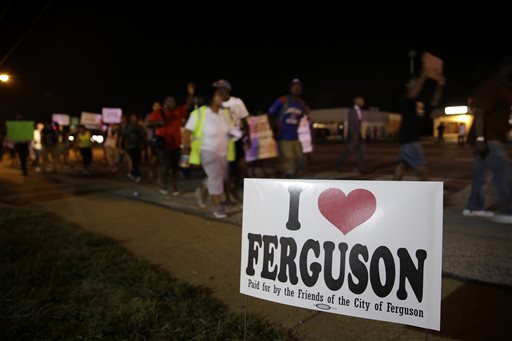 Protesters march Thursday in Ferguson, Mo.  (AP Photo/Jeff Roberson)