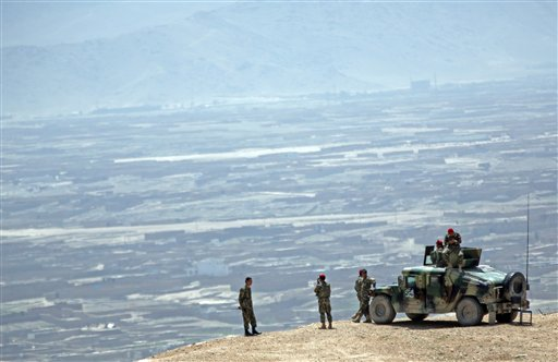 Afghan National Army (ANA) soldiers standing guard during a military exercise on the outskirts of Kabul, Afghanistan  (AP Photo/Massoud Hossaini)