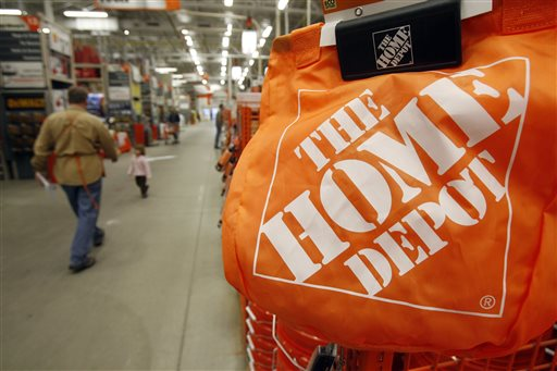 Shoppers walk through the aisles at the Home Depot store in Williston, Vt.   (AP Photo/Toby Talbot)