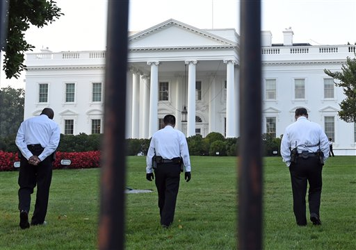 Uniformed Secret Service officers walk along the lawn on the North side of the White House  (AP Photo/Susan Walsh)