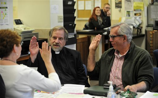 Tony Larsen, 65, pastor at Olympia Brown Unitarian Universalist Church, left, and partner Craig Matheus, 62, verify their vital information with Joanne Smith, deputy clerk as they apply for a marriage license on Monday in the County Clerk's office inside the Racine County Courthouse  (AP Photo/The Journal Times, Soctt Anderson)