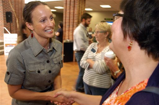 U.S. Senate candidate Amanda Curtis greets supporter Danell Jones during a campaign event in Billings, Mont.  (AP Photo/Matthew Brown)