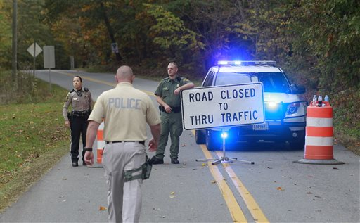 Albemarle County police block off a section of Old Lynchburg Road south of Red Hill Road Saturday  (AP Photo/The Daily Progress, Andrew Shurtleff)