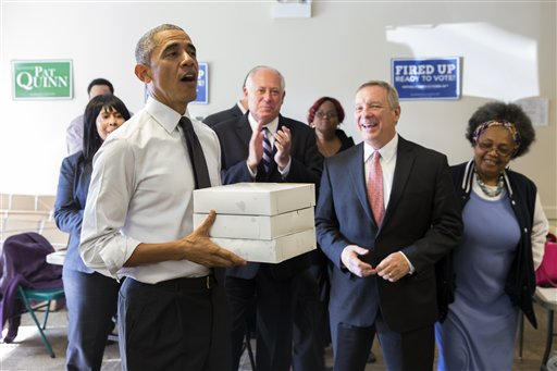 Gov. Pat Quinn, D-Ill., center, and Sen. Dick Durbin, D-Ill., second from right, watch as President Barack Obama delivers doughnuts and pastries to Democratic campaign volunteers (AP Photo/Evan Vucci)