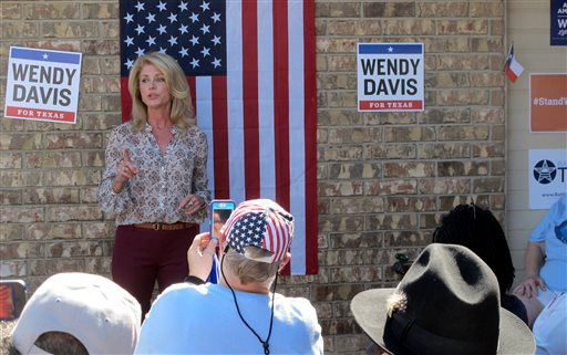 Texas Democratic gubernatorial nominee Wendy Davis greets supporters before a block-walking session on Saturday in Killeen  (AP Photo/Will Weissert)