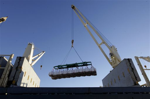 Rice bound for Japan is loaded aboard a ship at the Port of Sacramento  (AP Photo/Rich Pedroncelli)