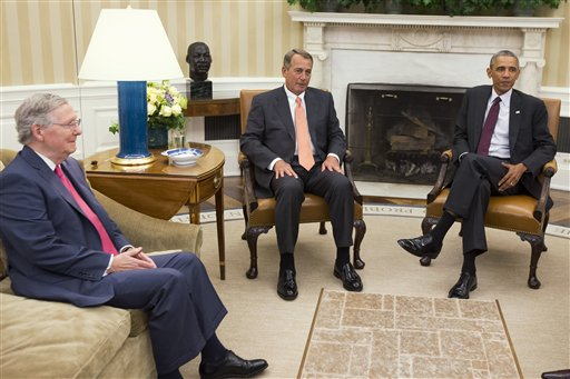 President Barack Obama meets with Senate Minority Leader Mitch McConnell of Ky., left, and House Speaker John Boehner of Ohio in the Oval Office of the White House (AP Photo/Evan Vucci, File)