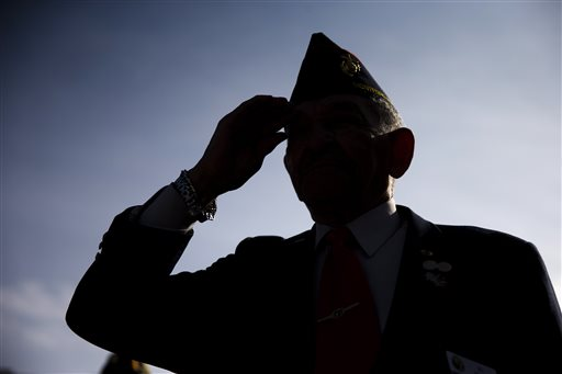 Al Willis, a Montford Point Marine, salutes during a ceremony on Veterans Day, Tuesday (AP Photo/Matt Rourke)