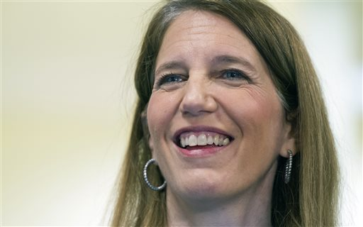 Health and Human Services Secretary Sylvia Burwell smiles while answering a reporters question following her tour of the Greater Prince William Community Health Center, Evergreen Terrace Site, in Manassas, Va.  (AP Photo/Cliff Owen)