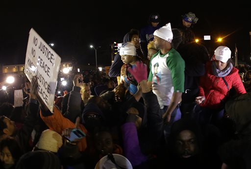 Louis Head, Michael Brown's stepfather, and Brown's mother Lesley McSpadden (AP Photo/Charlie Riedel)