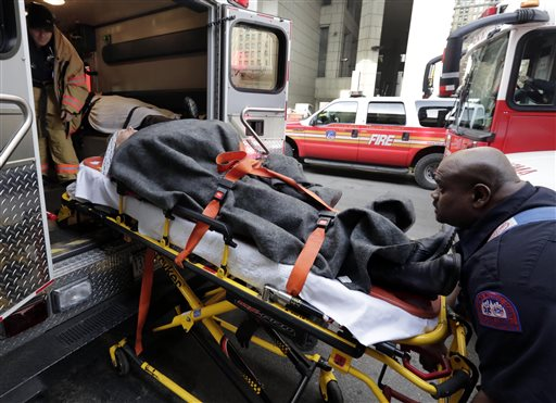 Injured passenger of a New Jersey ferry is loaded into an ambulance, in New York (AP Photo/Richard Drew)