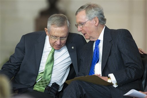 Senate Majority Leader Sen. Harry Reid of Nev., left, talks with Senate Minority Leader Sen. Mitch McConnell of Ky. on Capitol Hill (AP Photo/Evan Vucci)