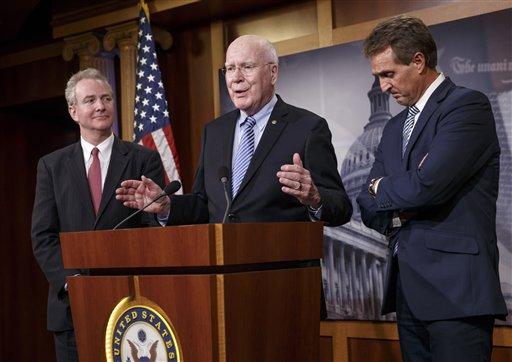 Rep. Chris Van Hollen, D-Md., Sen. Patrick Leahy, D-Vt., and Sen. Jeff Flake, R-Ariz., participate in a news conference on Capitol Hill  (AP Photo/J. Scott Applewhite)
