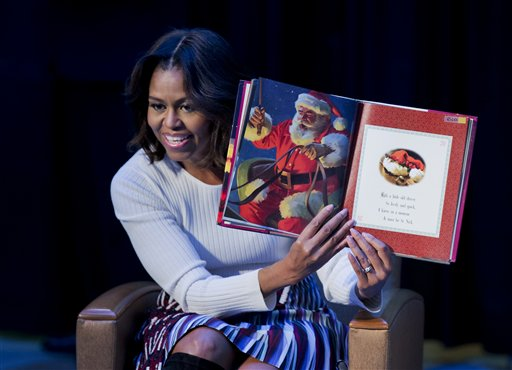 """First lady Michelle Obama, reads """"Twas the night before Christmas"""" to patients, families, and staff at Children's National Health System in Washington  (AP Photo/Manuel Balce Ceneta)"""
