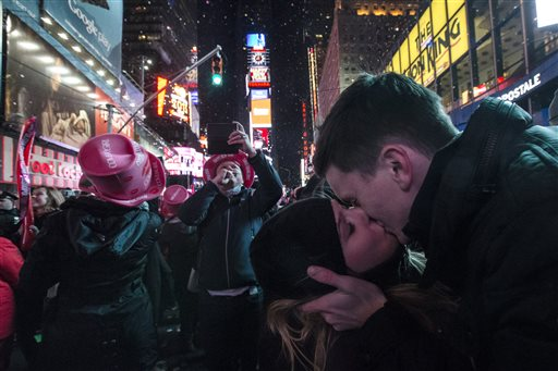 Sean Reilly and Emily Verselin share a kiss at midnight in Times Square during New Year's Eve celebration, Thursday  (AP Photo/John Minchillo)