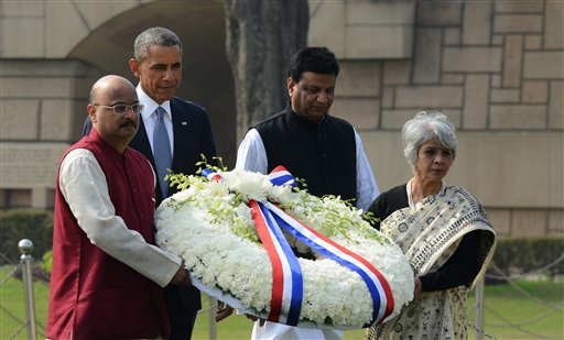U.S. President Barack Obama arrives to offer floral tributes at the site where Indian independence icon Mahatma Gandhi was cremated in New Delhi, India  (AP Photo)