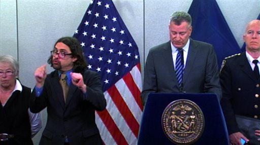 Sign-language Interpreter Jonathan Lamberton, left, translates during a news conference by New York City Mayor Bill de Blasio  (AP Photo/ New York City Office of The Mayor)