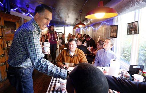 Former GOP presidential candidate Mitt Romney visits with diners at Little Dooey, a barbecue restaurant in Starkville, Miss.  (AP Photo/Rogelio V. Solis)