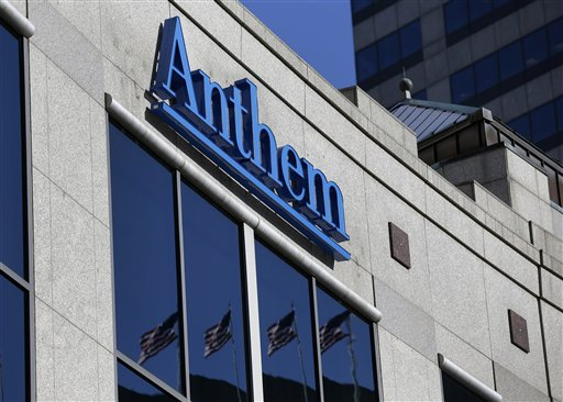 Anthem logo hangs at the health insurer's corporate headquarters in Indianapolis.  (AP Photo/Michael Conroy)