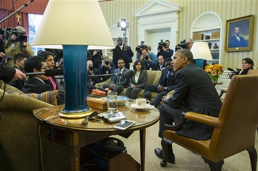"President Barack Obama meets with a group of ""Dreamers"" in the Oval Office of the White House in Washington.  (AP Photo/Evan Vucci)"