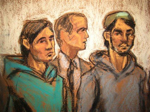 Akhror Saidakmetov, left; attorney Adam Perlmutter, center; and defendant Abdurasul Hasanovich Juraboev, appear at federal court in New York on terrorism charges. (AP Photo/Jane Rosenberg)
