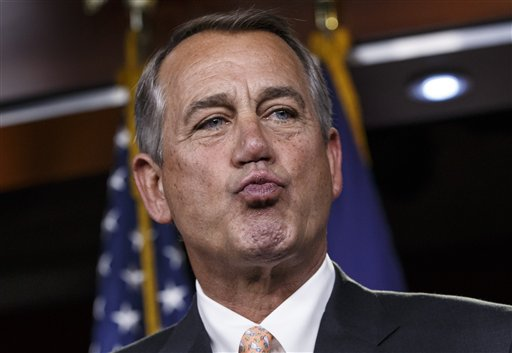 House Speaker John Boehner of Ohio responds to reporters. (AP Photo/J. Scott Applewhite)