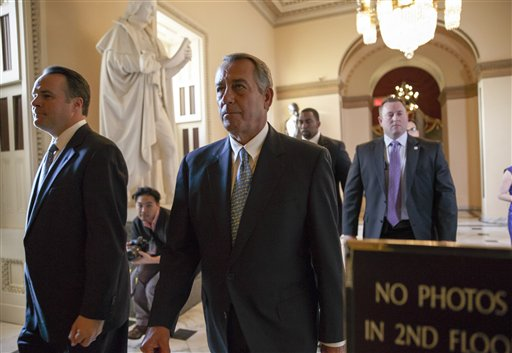 Speaker of the House John Boehner, R-Ohio, walks to the chamber as the House failed to advance a short-term funding measure to keep the Department of Homeland Security funded past a midnight deadline, at the Capitol.  (AP Photo/J. Scott Applewhite)