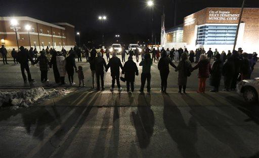 Protestors block traffic outside the Ferguson, Mo., police department.  (AP Photo/Charles Rex Arbogast)