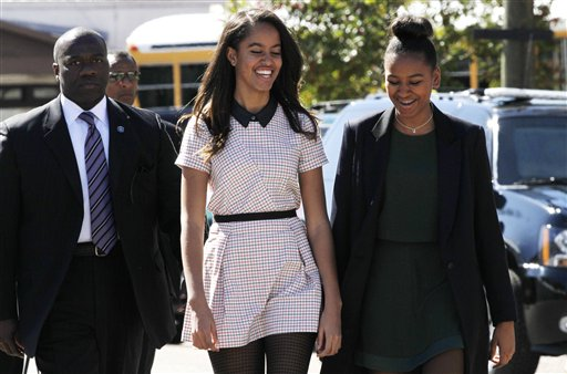 "Malia Obama, left, and sister Sasha Obama laugh together as they leave a speech by their father President Barack Obama at the Edmund Pettus Bridge in Selma, Ala., on the 50th anniversary of ""Bloody Sunday,"" a landmark event of the civil rights movement, Saturday.   (AP Photo/Jacquelyn Martin)"