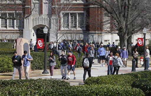 People walk on the Oval at the University of Oklahoma in Norman, Okla.  (AP Photo/Sue Ogrocki)