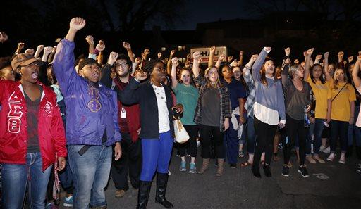 University of Oklahoma students rally outside the now closed University of Oklahoma's Sigma Alpha Epsilon fraternity house during a rally in Norman, Okla. (AP Photo/Sue Ogrocki)