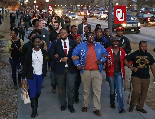University of Oklahoma students march to the now closed University of Oklahoma's Sigma Alpha Epsilon fraternity  (AP Photo/Sue Ogrocki)