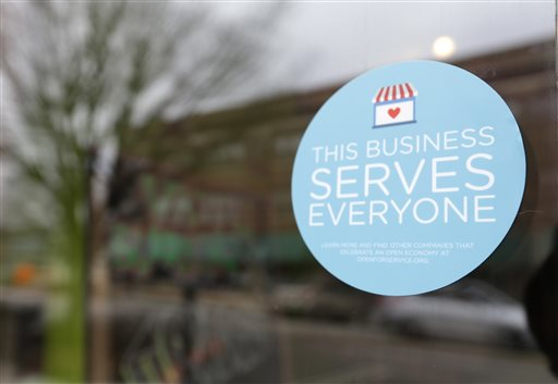 A window sticker on a downtown Indianapolis business.  (AP Photo/Michael Conroy)