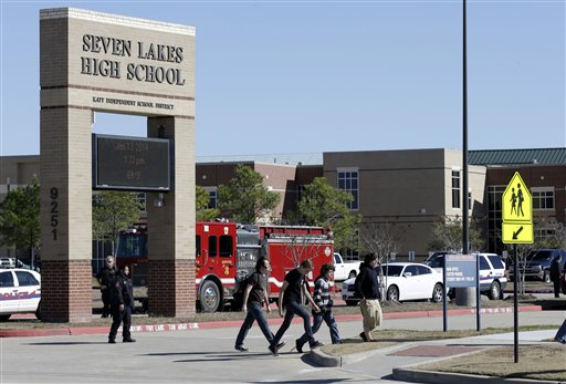 Students pass by Seven Lakes High School after being evacuated and released from school for the day after a bomb squad was called to the school after a potentially explosive device was found.  (AP Photo/Pat Sullivan, File)