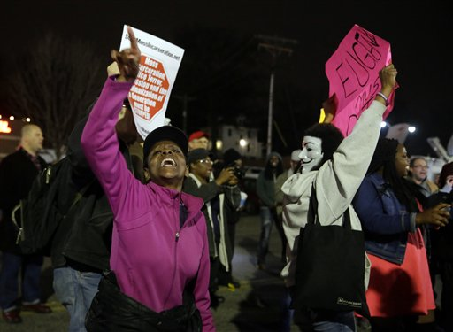 People demonstrate across the street from the Ferguson Police Department.   (AP Photo/Jeff Roberson)