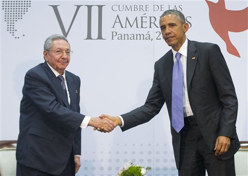 President Barack Obama and Cuban President Raul Castro shake hands during their meeting at the Summit of the Americas in Panama City.  (AP Photo/Pablo Martinez Monsivais)