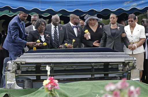 Judy Scott, second from left, mother of Walter Scott, is escorted to her son's casket during his burial service in Charleston, S.C.  (AP Photo/Chuck Burton)