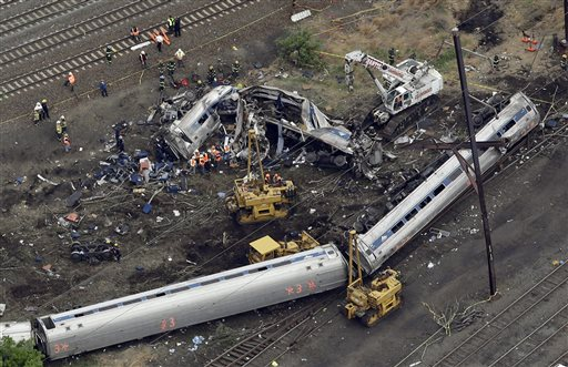 Emergency personnel work at the scene of a deadly train derailment, Wednesday.  (AP Photo/Patrick Semansky)