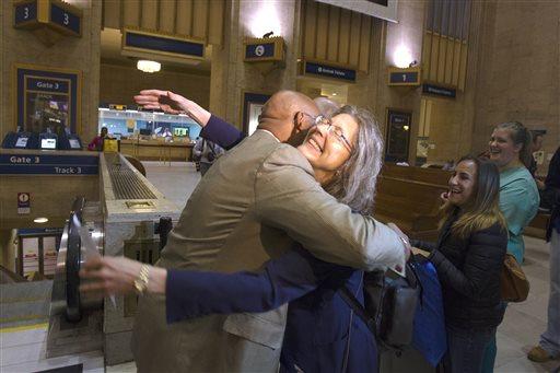 Philadelphia Mayor Michael Nutter hugs Mary Schaheen, the first passenger in line for Train 110 at Philadelphia's 30th Street Station, Monday. (AP Photo/Michael R. Sisak)