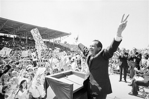 Richard Nixon flashes the victory sign as he acknowledges cheers from the crowd in 1968 at the fairgrounds of Springfield, Mo.  (AP Photo/File)